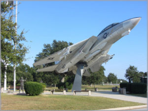 Image of a fighter plane on a museum pedestal to symbolize our involvement with aviation law.