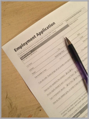 Image of employment application with pen resting on it to symbolize our involvement with employment law.
