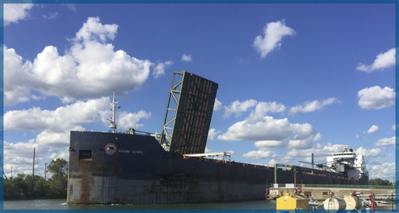 A great Lakes cargo ship going under a lift bridge in the Welland Canal for the June 2017 newsletter.